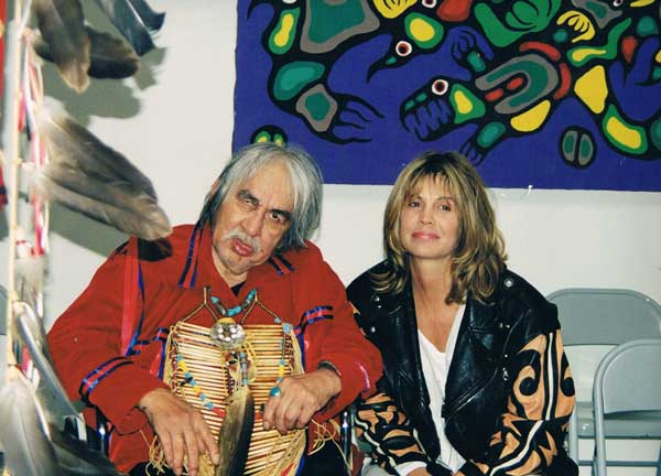 Norval Morrisseau and Josie Sschwiola who bought the painting behind them.