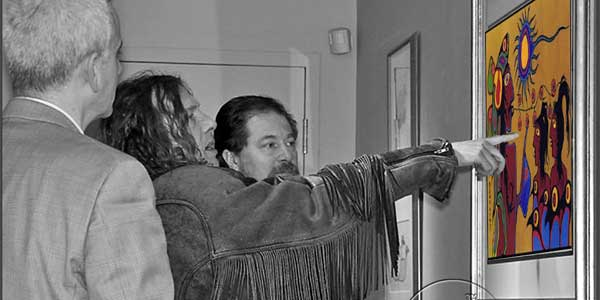 "Ritchie Sinclair, in one of his Davy Crockett outfits, instructing the staff of Kinsman Robinson Galleries on why they should never have published this picture and four others in ""Travels"" in 1997. Raising the question, of course, how could Norval Morrisseau have made such a huge mistake when he picked the pictures for his own book? Unless he had advanced Dementia. All the pictures were removed, holus bolus, from the slightly ammended book when re-issued as ""Return to the House of Invention"" in 2005. Sinclair still posts them all as ""fakes"" in 2013, but has removed any and all links or associations with ""Travels"" and ""Return,"" Norval Morrisseau, Donald Robinson, and the Kinsman Robinson Galleries. Hiding stuff is usual, and transparency is not a strong suit for Conspiracy Theorists."