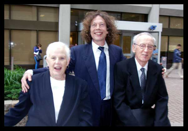 The Collaborators Outside the Court - Probably the most damaging photo ever published about a judicial proceeding in Canadian history; I predict it will be used in legal text books, by generations to come. Sinclair and Robinson right, outside the courtroom where the tag-team performed for Conspiracy Theorist Proxy #4, Margaret Hatfield . The association has cost her some $40,000 wasted on a case she could never win.