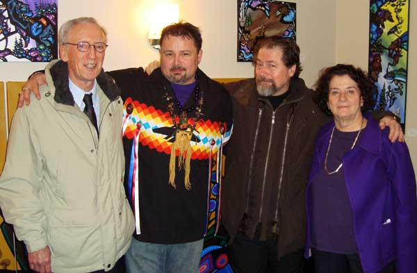 "KISSING COUSINS - A fine photo that shows the lovingly close relationship between Kinsman Robinson Galleries, Conspiracy Theorist extremists and members of the Norval Morrisseau Heritage Society. In loving embrace with Trudy Nicks, from the Royal Ontario Museum and an NMHS director, are John MacGregor Newman (KRG),  Mark Anthony Jacobson, who is an aggressive ""enforcer"" for the Conspiracy Theorists. At the far left is Donald Robinson, trying, as always to distance himself from his more than cosy relationship with members of the NMHS. Photos of its members always exclude him because everyone knows he's the 800 pound gorilla in the room."