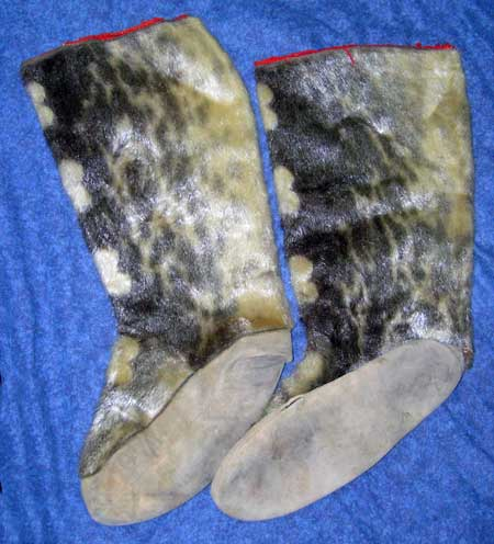 "My sealskin mukluks which accompanied me on many hunts for seal, moose, and caribou in Canada's high arctic and sub-arctic wilderness, in the compnay of Inuit and Dene hunters going out to get meat to supply our families because in these remote areas ""store-bought"" meat is just way too prohibiitly expensive even for teachers."
